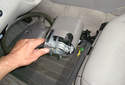 This picture illustrates the front of the turn signal switch/steering column cover.