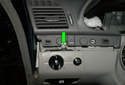 Pull up on the left corner of the dashboard upper panel slightly and remove the T30 Torx fastener for the headlight switch.