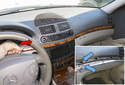 Slide the entire wood trim strip in the direction of the red arrow a few inches then pull the wood trim strip away from the dashboard to remove it.