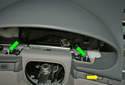 Working inside the opening of the instrument cluster opening remove the two T30 Torx fasteners (green arrows) already loosened.