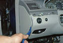 Using a plastic prying tool lever off the left side dashboard cover.