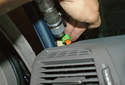 Unplug the side curtain airbag electrical connector (green arrow) by squeezing the connector and pulling it out of the side airbag.