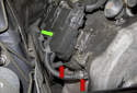 Each ignition coil (green arrow) has two ignition wires running to spark plugs (red arrows).