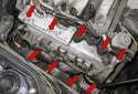 Remove the nine E10 valve cover fasteners (red arrows).