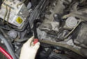 Once all the fasteners are removed, move the engine oil tube away from the corner of the valve cover.