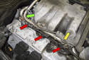 Working at the right side valve cover, disconnect the fuel injector electrical connectors by squeezing the release tabs and pulling them straight off (red arrows).