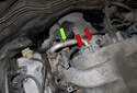 Working at the rear of the intake manifold, remove the EGR tube (green arrow).