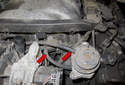 Next, remove the vacuum hoses at the left side secondary air valve and the solenoid (red arrows).