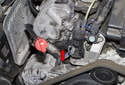 On W211 models with a 6-cylinder engine, the camshaft sensor is located at the right cylinder head, mounted in the timing cover (red arrow).