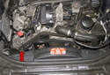 The alternator on W211 models with a 6-cylinder engine is located on the right side of the engine (red arrow).