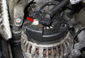 Then remove the 13mm alternator positive (+) cable fastener (red arrow).