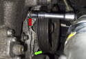 Directly above the fastener you just removed (green arrow) is the final E12 pump fastener (red arrow).
