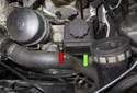 Next, remove the E10 power steering reservoir fastener (red arrow).