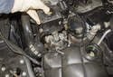 Next, remove the pump from the engine and drain the remaining fluid into a suitable container.