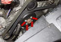 Before removing the engine drive belt, loosen the four 10mm water pump pulley fasteners (red arrows).