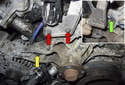 Remove the two E10 solenoid bracket fasteners (red arrows).