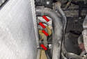 Move to right side of the radiator and remove the four hoses.