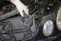 Pull the air dam away from the radiator and detach it from the radiator support.