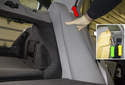 Rear Seat: Lift the seat cushion up (red arrow) and detach the clip (green arrow) from the mount (yellow arrow).
