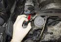 Pressure testing: Remove the fuel test port cap (red arrow).