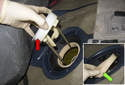 Slowly lift the fuel pump module top up and remove it.