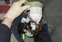 Slide the new fuel filter assembly into the fuel tank.