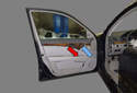 The options switches, such as power window (red arrow) and power seats/mirrors (blue arrow) can be replaced once the door panel is removed.