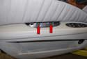 Remove the center door panel T30 Torx fasteners (red arrows).