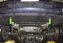 Working at the lower radiator splash shield, remove the two 8mm fasteners (green arrows).