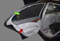 The integrated rear sun-shade (green arrow) commonly wears out over time, tearing or developing holes.