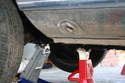 Place the jack stands under the reinforced chassis section inboard of the front external jack points (hole in rocker panel).