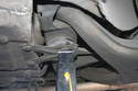 The mounting point for the rear subframe is a strong place for the jack stand.