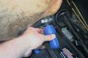 If the battery cable terminals are corroded, clean them with a terminal-cleaning tool.
