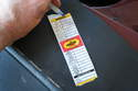 An oil change sticker helps keep track of when service is performed and needed.