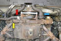 With the tray removed you can see the coolant hoses on the front of the motor.
