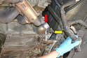 With the hoses off you can see the outlet for the thermostat (red arrow) and the heater core (yellow arrow).