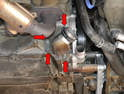 Use your E10 and remove the four bolts holding the thermostat housing in place (red arrows).