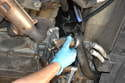 Pull the thermostat and housing from the engine.