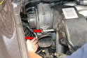 Use a 10mm socket and remove the two bolts that hold the blower motor and intake duct to the manifold (red arrows).