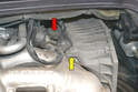 Use a 10mm wrench and remove the bolt that holds the wiring harness and air box to the top of the intake manifold (yellow arrow).