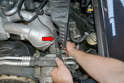 Next use your flex-shaft and 7mm socket and loosen the clamp connecting the inside of the airbox housing to the lower hose (red arrow).