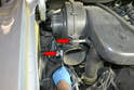 Use a 10mm socket and remove the two bolts holding the blower to the manifold (red arrows).