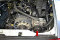 On both the Varioram and non-Varioram Porsche 993s the A/C compressor is located on the rear right side of the engine.
