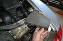 Remove the electrical panel plastic protector by lifting it up from the bottom and removing it from the right ear corner of the engine compartment.