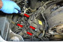 There are two Philips head screws that hold each distributor cap in place (red arrows).