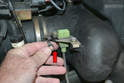 Swing out the retaining clip (red arrow) from the bottom and slide the connection out from the mount.