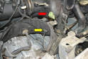 Pass the connection through the grommet in the shroud (yellow arrow).