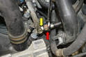 On the right side rail use a 17mm wrench to support the rail (yellow arrow) and a 19mm wrench and separate the fuel line (red arrow).