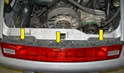 With the trim piece gone you can access the three retaining bolts (yellow arrows).