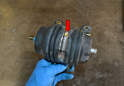 Take the filter to your bench and loosen the hose clamp and separate the pump from the base (red arrow).